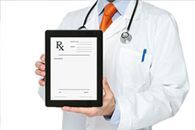 A doctor is holding an ipad that shows a prescription for a cpap